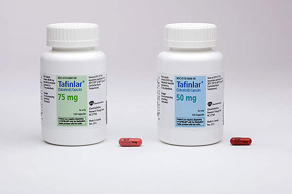 Tafinlar capsules are available in 50mg and 75mg capsules. Image courtesy of GlaxoSmithKline (GSK).