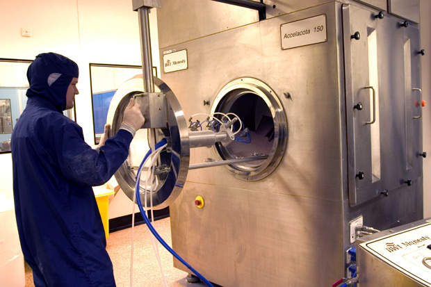 Commercial manufacturing of solid dosage forms