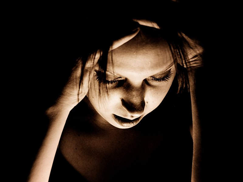 The symptoms of migraine include nausea, vomiting, and sensitivity to light or sound. Image courtesy of Sasha Wolff.