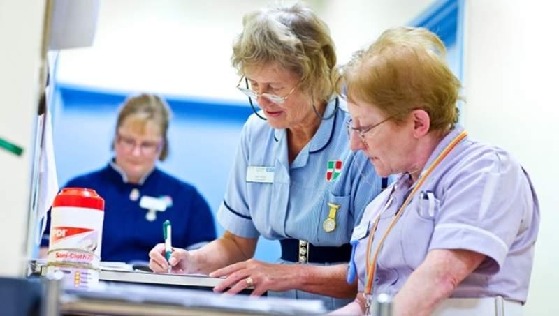 nurse talking, making notes